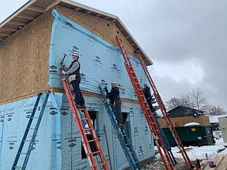 Blue Horseshoe employees building a house for Habitat for Humanity