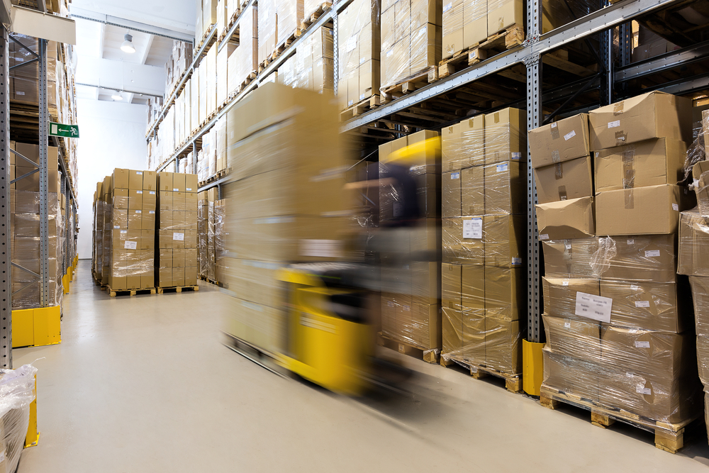Fork lift operator preparing products for shipment-1